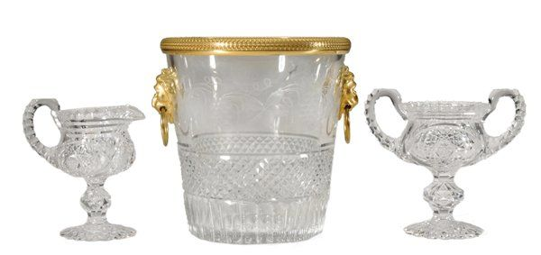 """19th/20th century: wine cooler or ice bucket with fine intaglio and cut decoration, lion's head ring mounts below gilt bronze rim, 8-3/4 in.; cut glass sugar and creamer with hobstar decoration and serrated handles, marked """"Libbey"""", each 6-1/4 in. - Sold $650"""