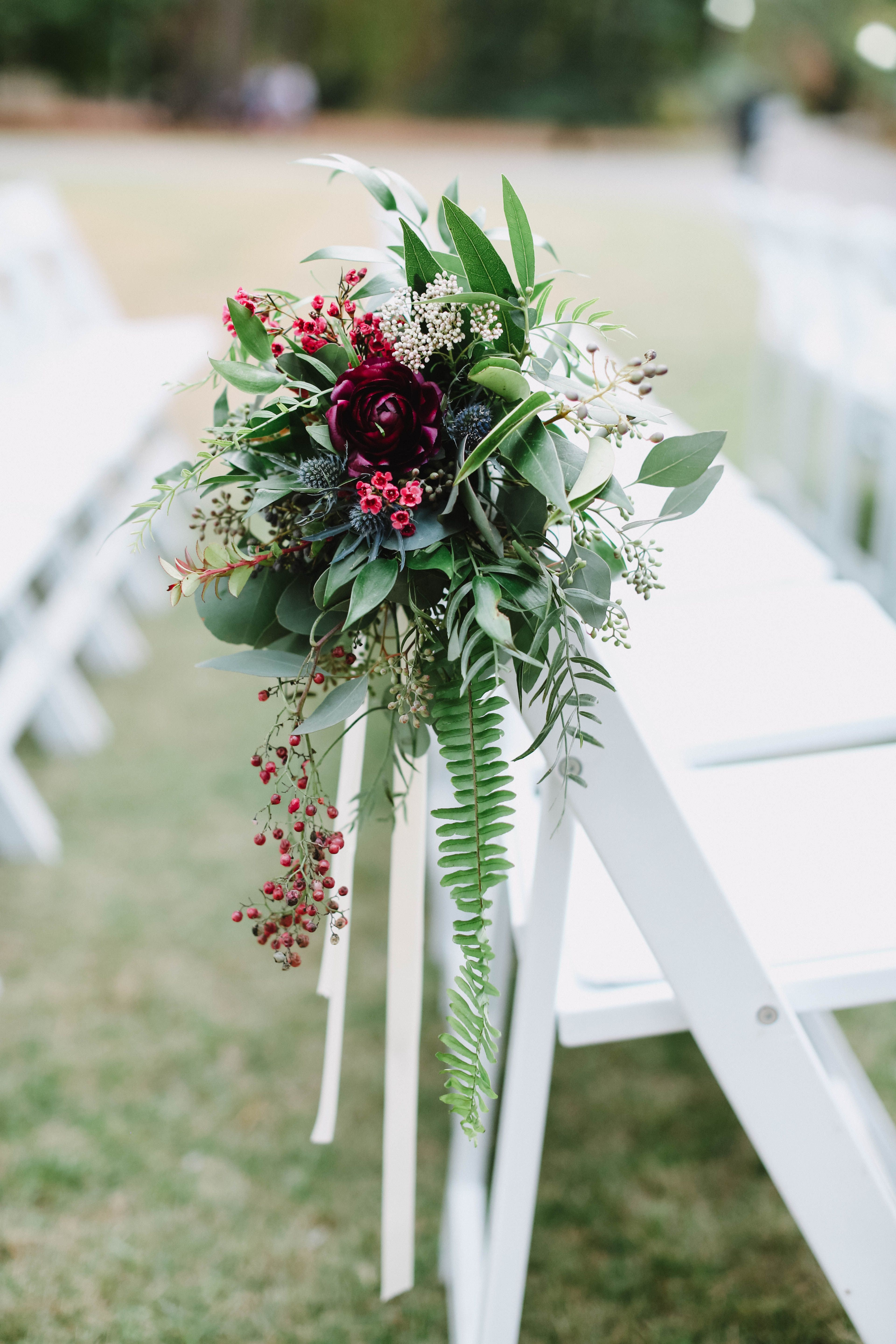 Aisle chair detail from November 2016 wedding. Florals by Studio Floral. Image by Jennifer Woodbery