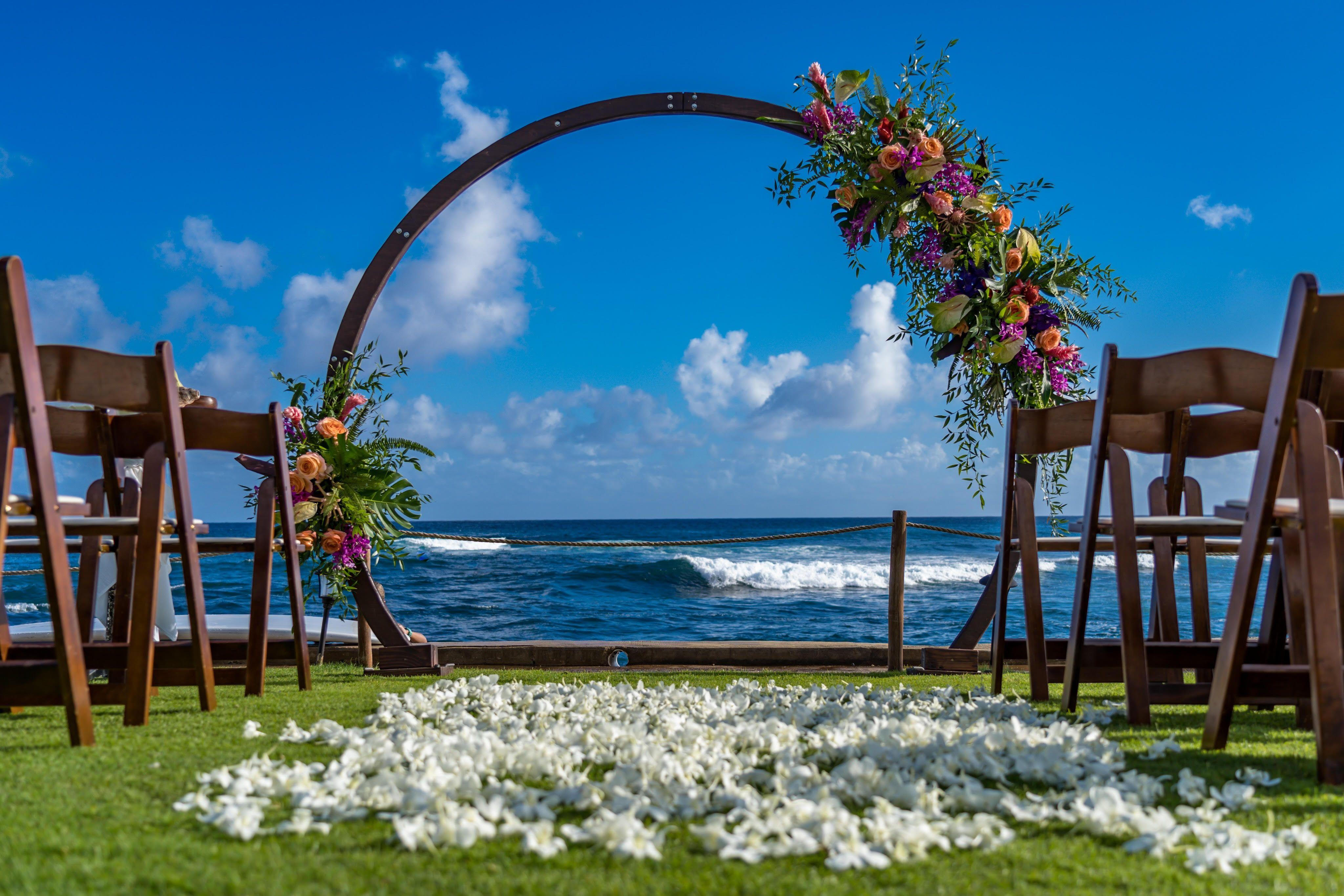 Vibrant Tropical Ceremony Oval Arch Oceanfront Kauai Destination Hawaii Wedding Oceanfront Wedding Hawaii Wedding Wedding Venues Beach
