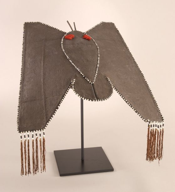 Yao Woman's Hat in the shape of a butterfly. China, mid 20th century Linen stretched over a basketry frame,wood, silk tassels and fringe, gl...
