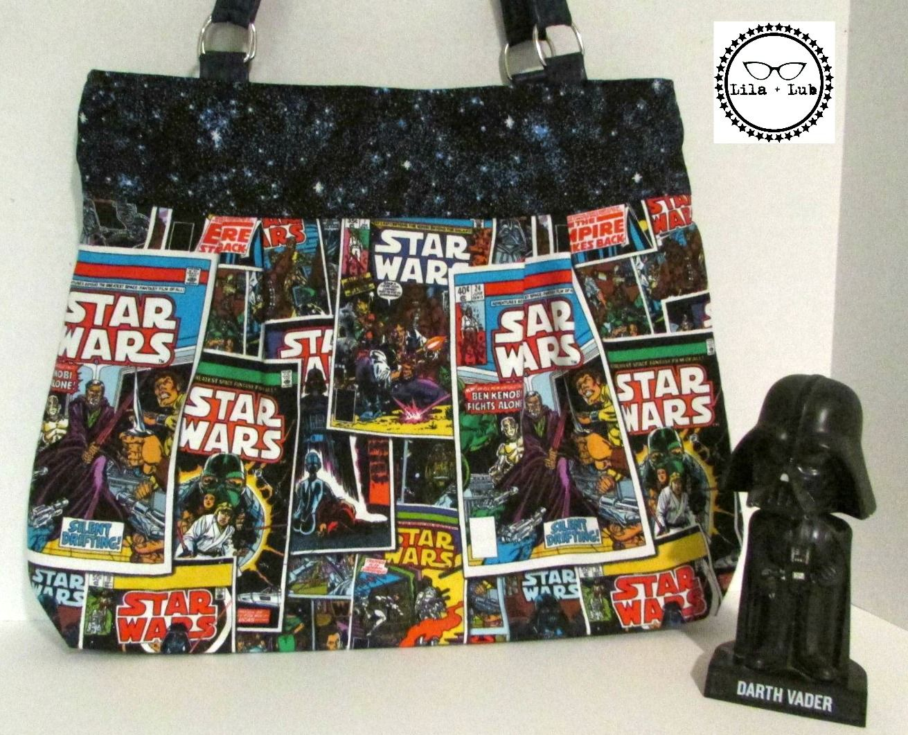 Carry the Force on your arm with this adorably geeky bag.   *14  inch opening with a magnetic snap closure. *13 inch strap drop Leatherette Straps *13 inched deep with a 4 inch base that allows this bag to stand on it's own . *Body of the bag Quilters Weight Cotton fabric. *Interfaced with ...