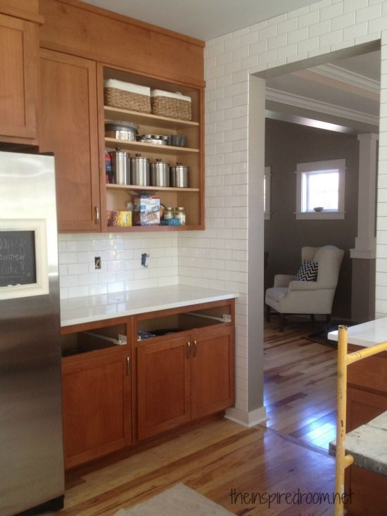 #Kitchen #remodel progress update on the blog! kitchen subway tile from floor to ceiling and over doorway, with white counters.