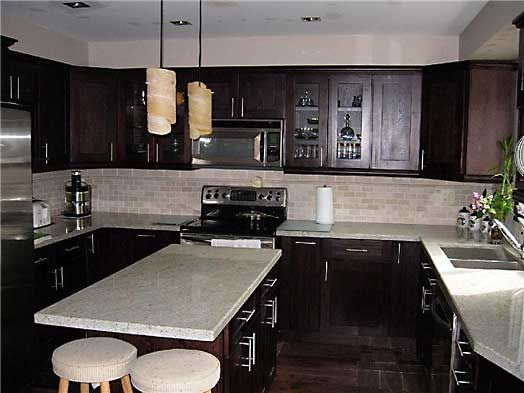 espresso kitchen! love the combination of dark cabinets and white granite!