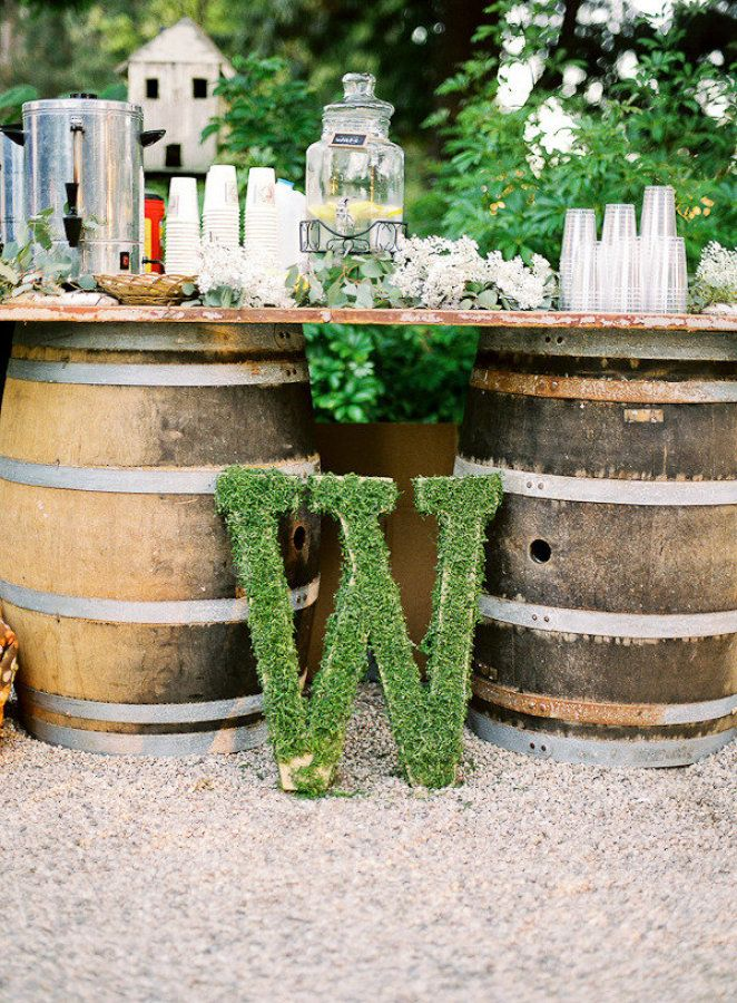 Old barrels used as drink table legs + Wedding Monogram | Fab Mood