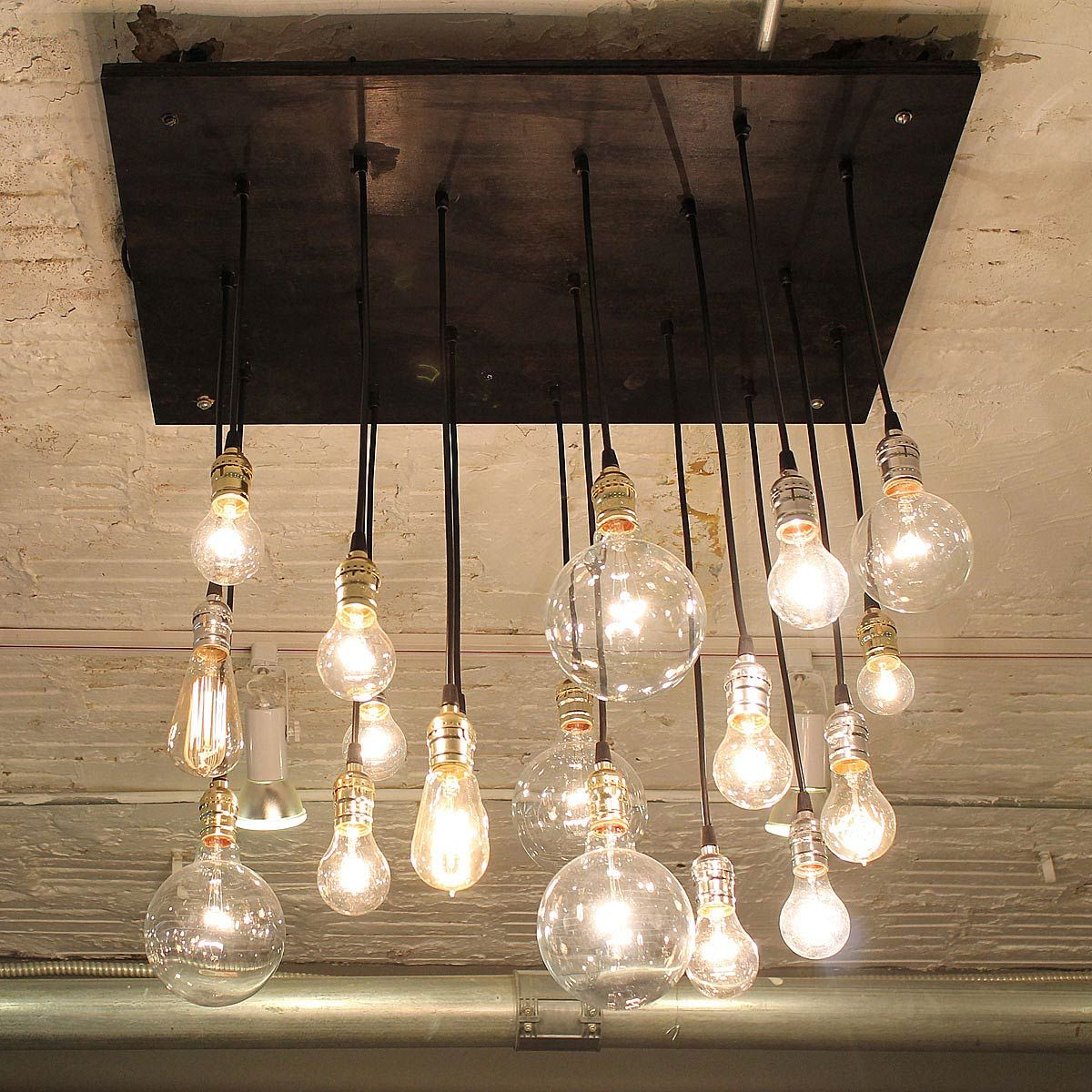 Bring Industrial Style To Your Home With This Antique Bulb And Reclaimed Wood Chandelier