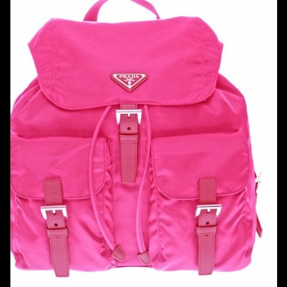 a807b5ad1286 NWT Prada Pink Backpack with Saffiano Trim NWT Prada Pink Backpack. This  has two front buckle pockets and one interior zipper pocket.