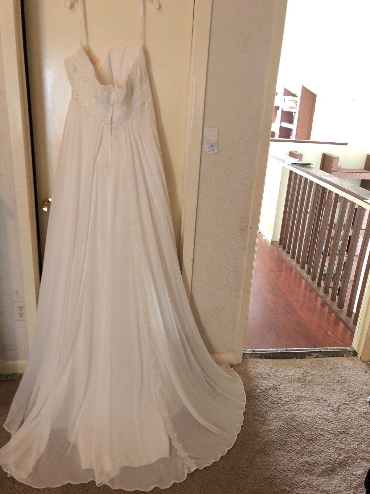 Size 24 wedding dress  Wedding Dress size  from Davidus Bridal Ivory color never worn