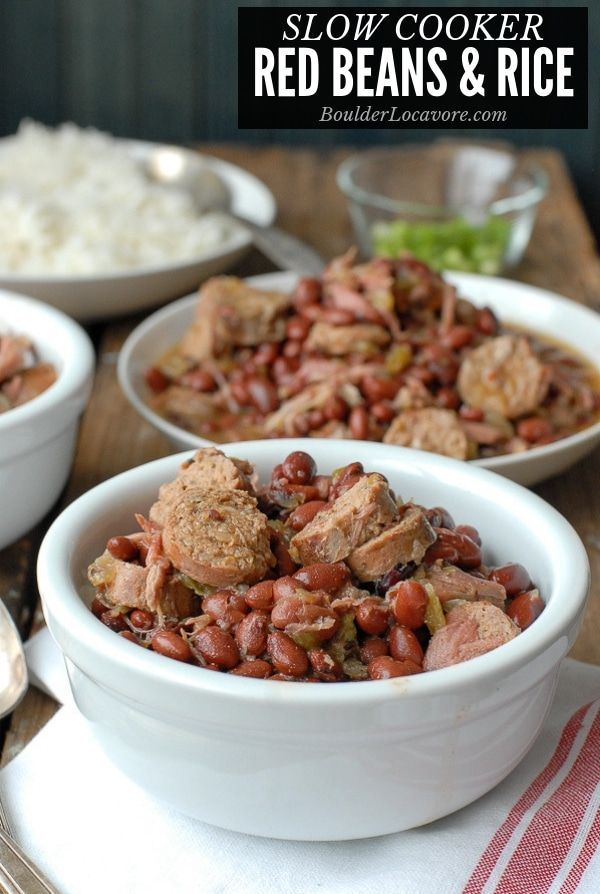 Smoky, spicy Louisiana Slow Cooker Red Beans and Rice. Full of Andouille sausage, ham hock, creole cajun spices. Fit for Mardi Gras or any day! Easy recipe packed with protein.
