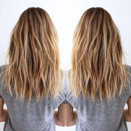 Shortly after shoulder-length hair