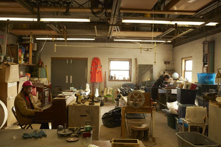 Artists Billy Dufala and Martha McDonald work on a joint performance piece in the artist studio Revolution Recovery, a dump in Philadelphia.