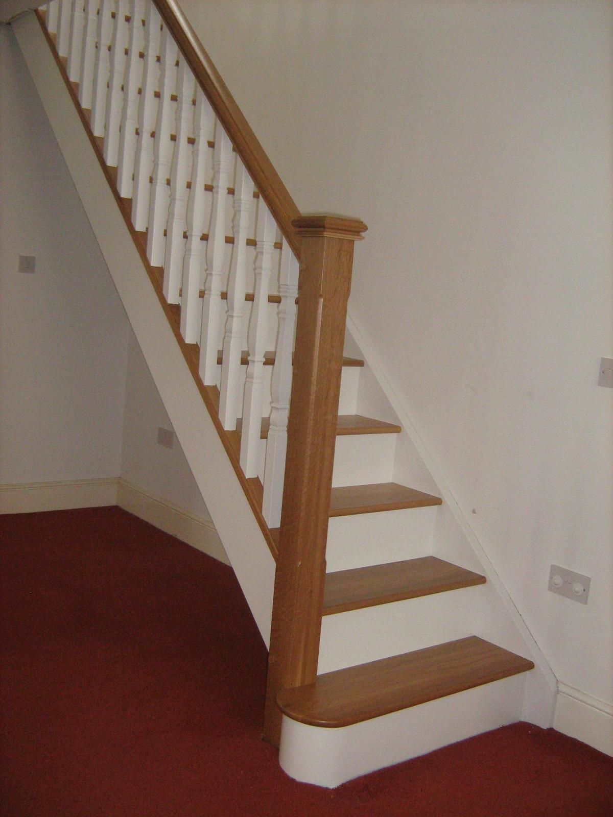 Oak and white staircase with white spindles. Would