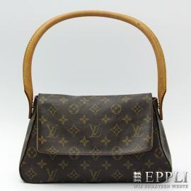 "LOUIS VUITTON handbag, model ""MINI Looping"".  description Toile Monogram, Model commercially not available, handle with stain and patina  Starting Bid. 1 Euro"