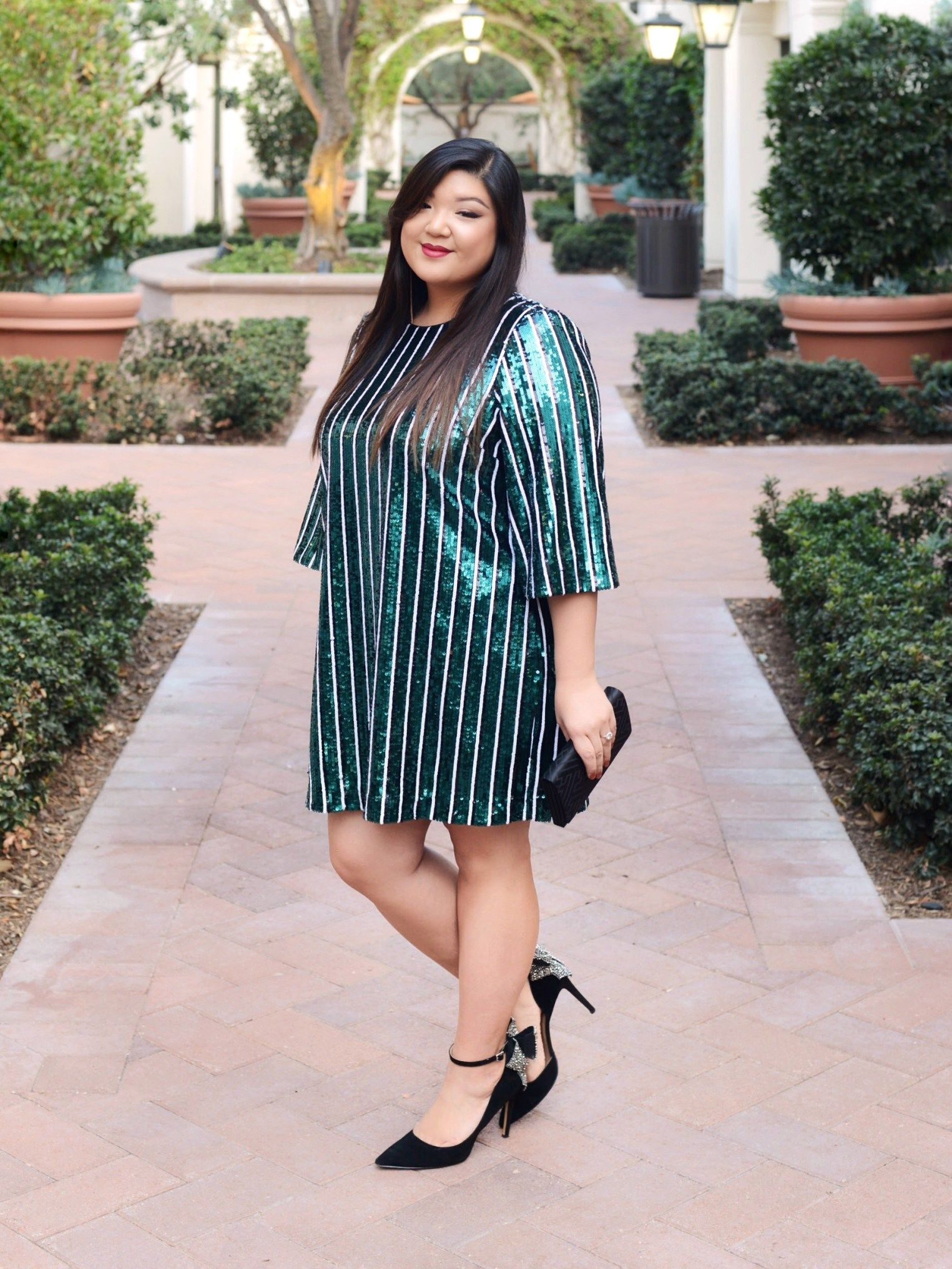 8e1cad6f4ec4 Curvy Girl Chic Plus Size Fashion Blog Holiday Sparkle Outfit with Badgley  Mischka Sequin Stripe Dress from Rent The Runway