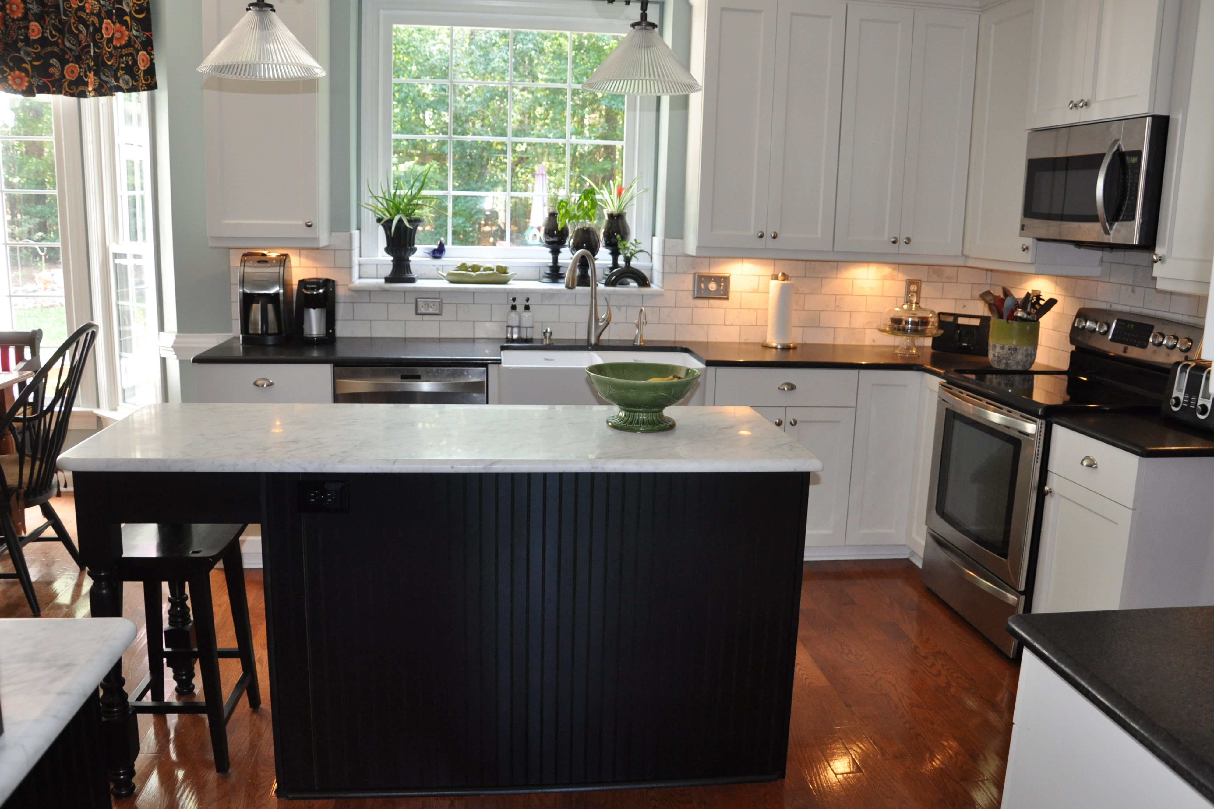 Countertops In Carrara Marble Honed Finish And Black Pearl Granite Leather  Finish. Full Kitchen Remodel