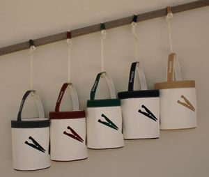 Peg bags made of white mesh and colorful framing / $45