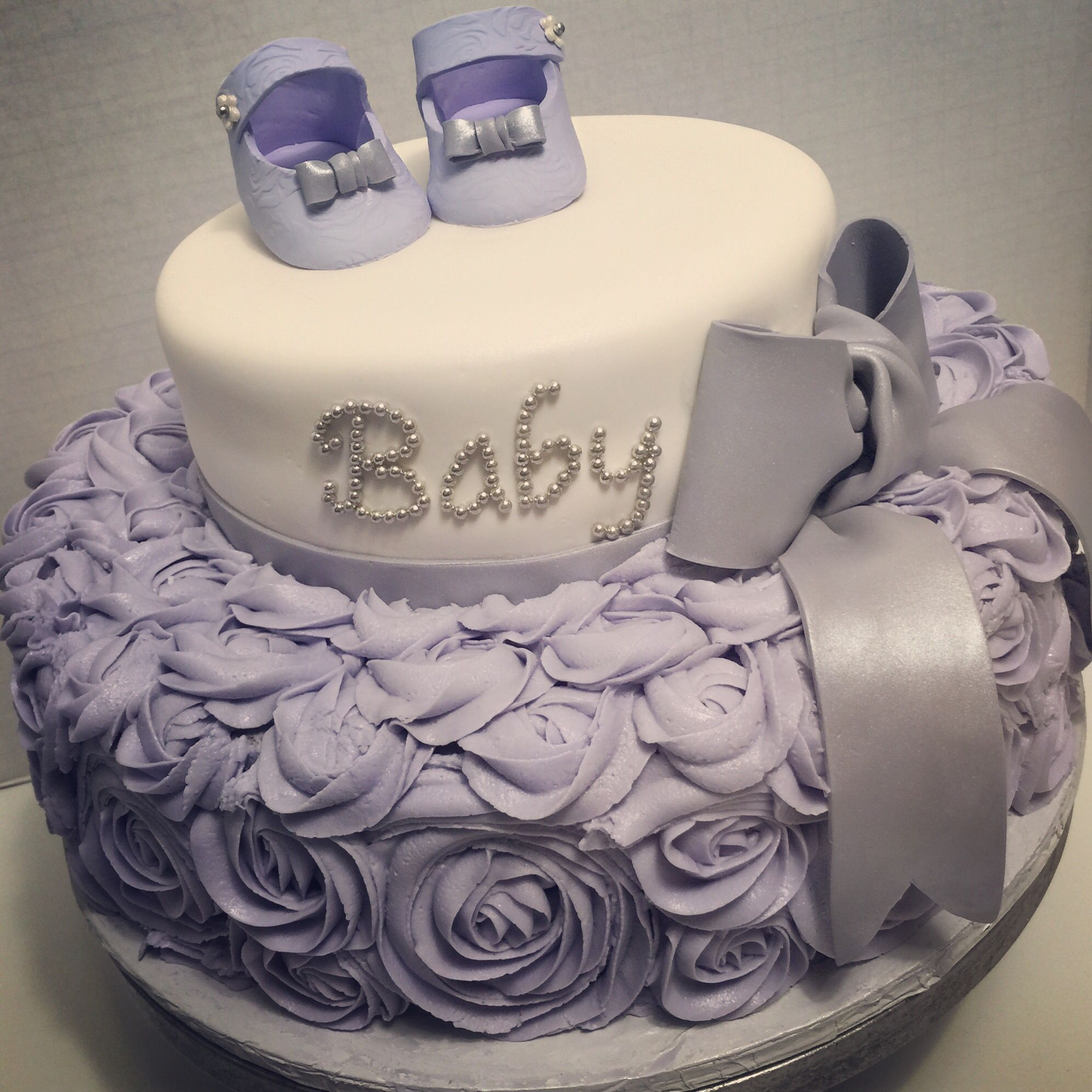 187ab75f7706a Lilac or lavender baby shower cake for girl. Baby shoes, bow, and ...