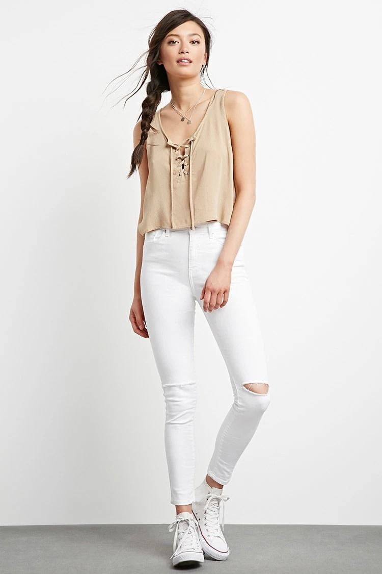 A pair of skinny jeans with distressing on the knees, a five-pocket construction, and a zip fly. #f21denim