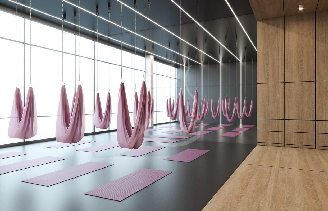 Fitness area furnished to host air yoga exercises, the warm matte wood cladding covers the entrance...