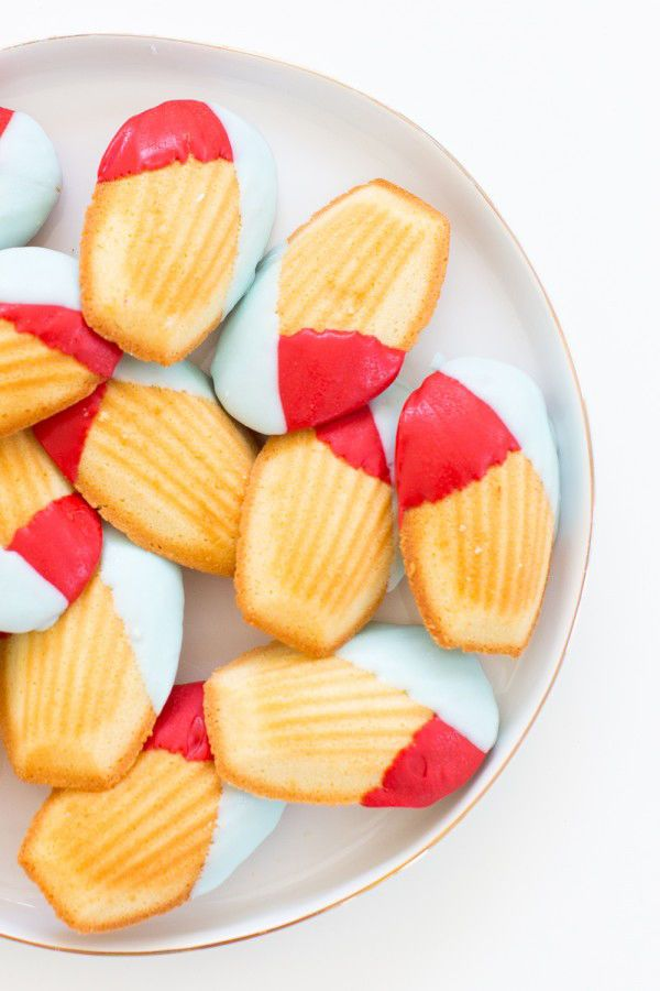 For your wedding dessert table, serve something simple like these madelines dipped in layers of brightly colored white chocolate.