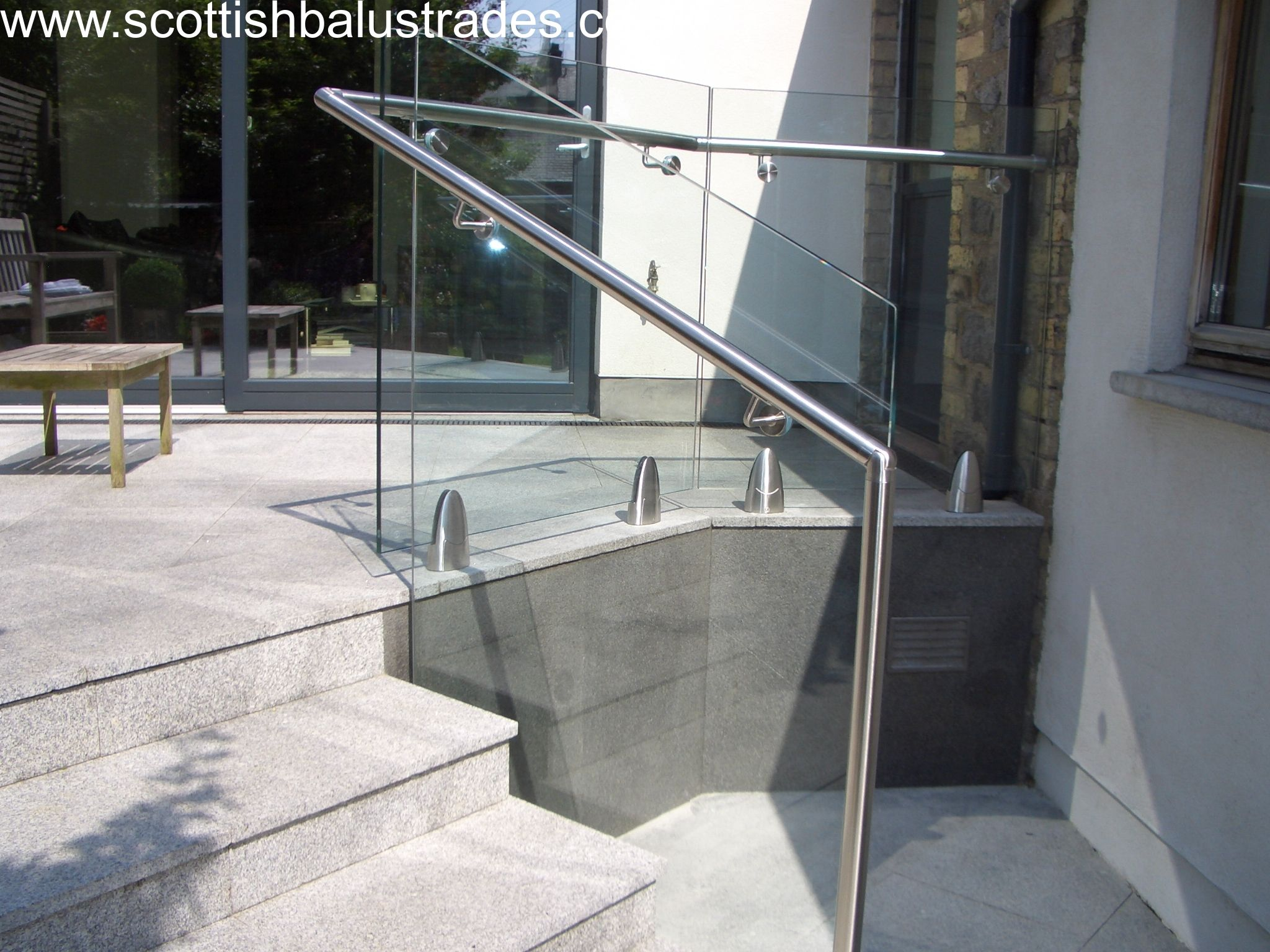 Frameless Glass Balustrade using Mod 6000 Glass clamps with side mounted  stainless steel handrail.