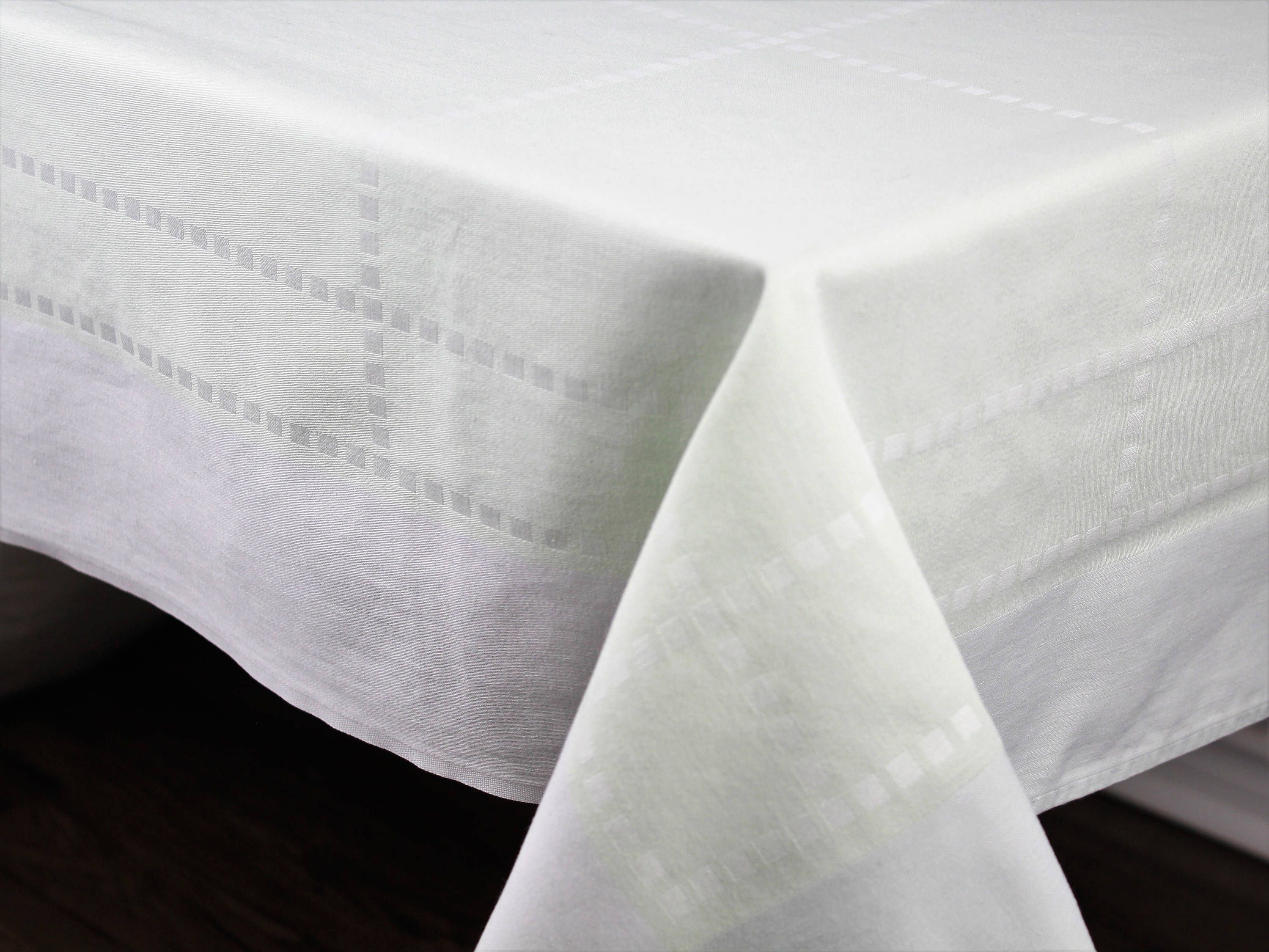 Pale pink polished cotton tablecloth with ornate design