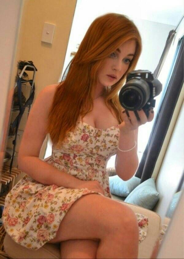 Sexy redhead pounded