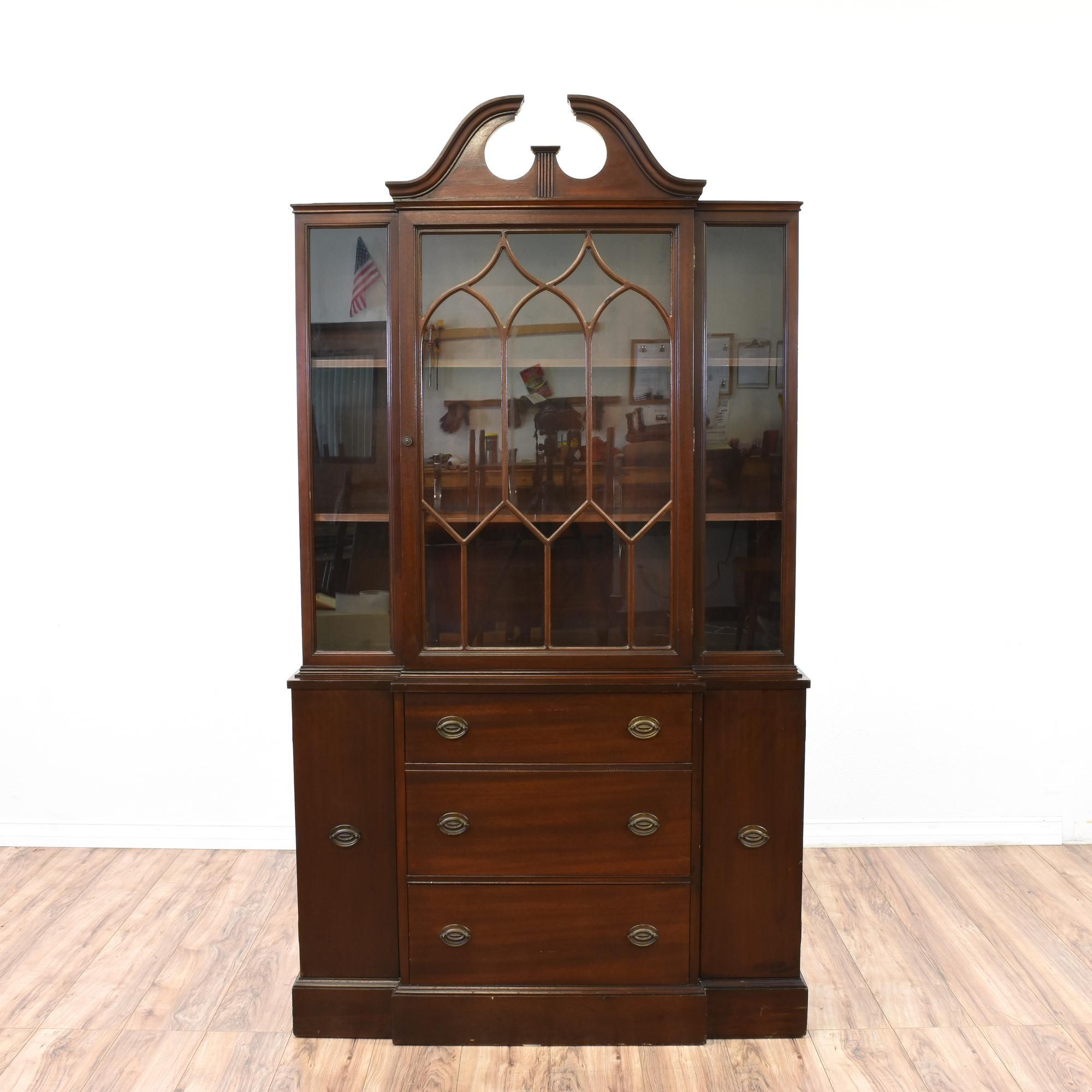This chippendale china cabinet is featured in a solid wood with a