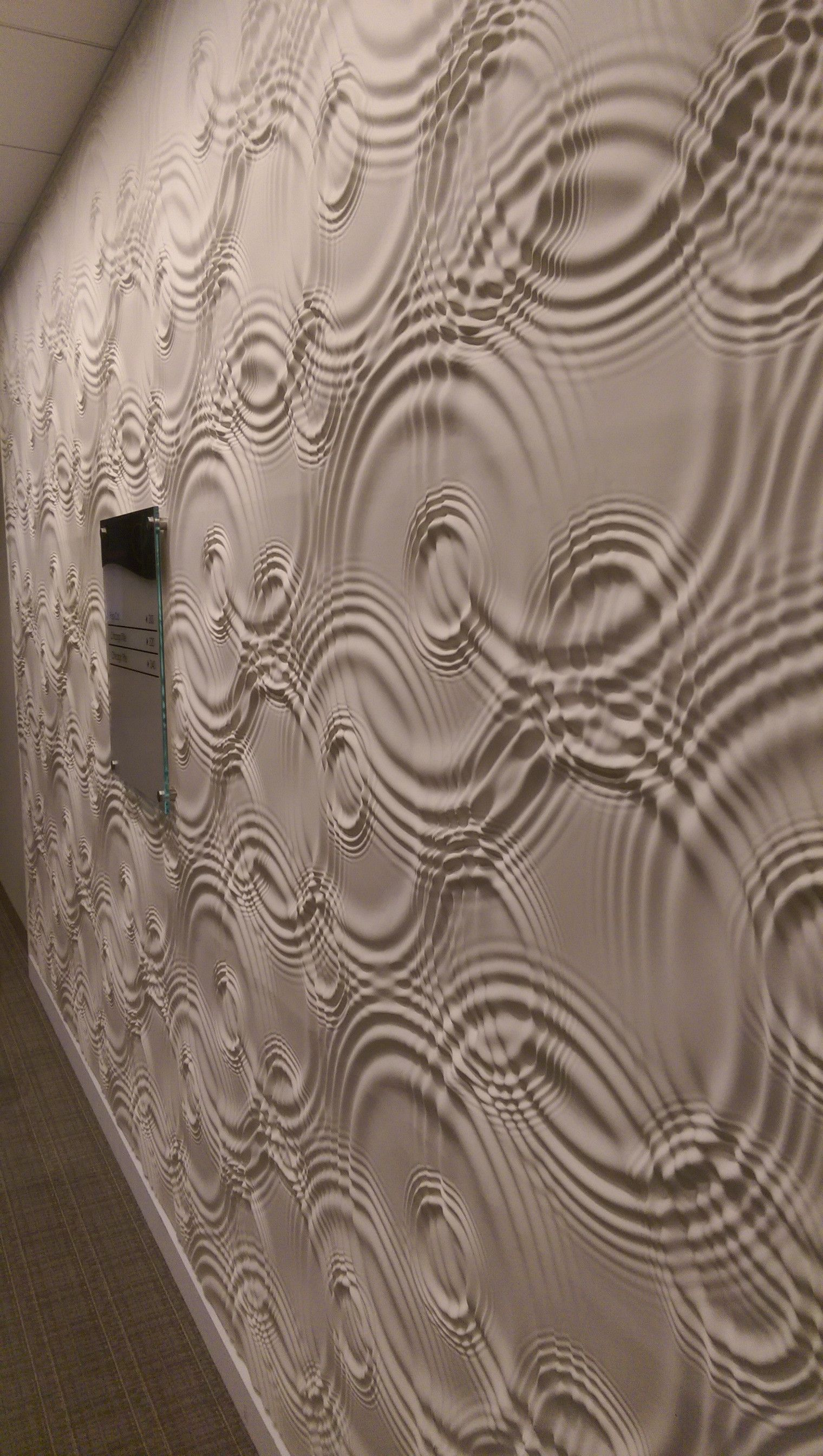 The texture on this wall looks like rippling liquid.