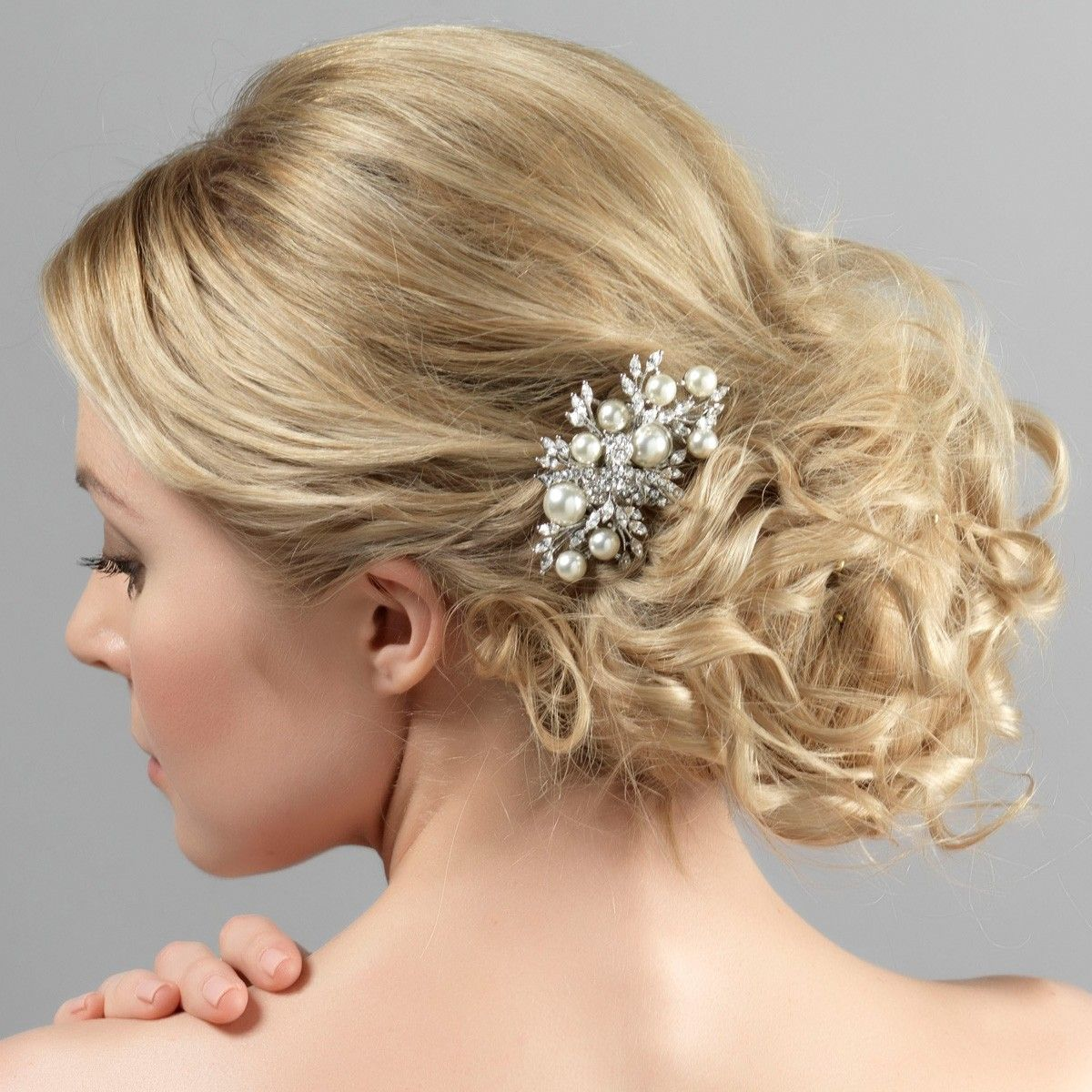 the enchanting pearl hair comb by glitzy secrets is the perfect pearl wedding hair accessory for a bride with a pearl theme that is vintage inspired