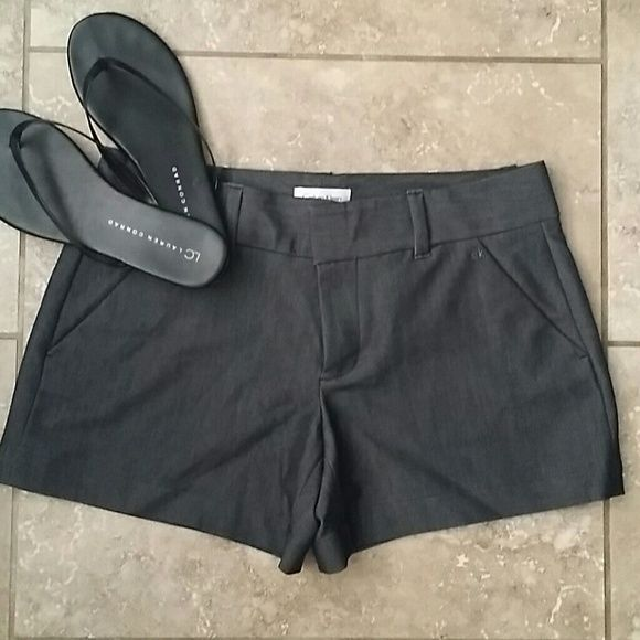 """CALVIN KLEIN DRESS SHORTS Calvin Klein charcoal gray dress shorts. Double clasp closure with interior button. 4"""" inseam. Welt pockets in front and double welt pockets on rear. 81% polyester, 15% rayon and 4% spandex. Great with heels or dressy sandals. Machine wash. No rips or stains. Smoke free home! Calvin Klein Shorts"""