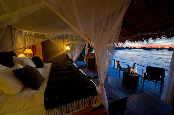 Sindabezi Island Private Camp in Zambia sleeping to the back drop of Amazing African Sunsets.