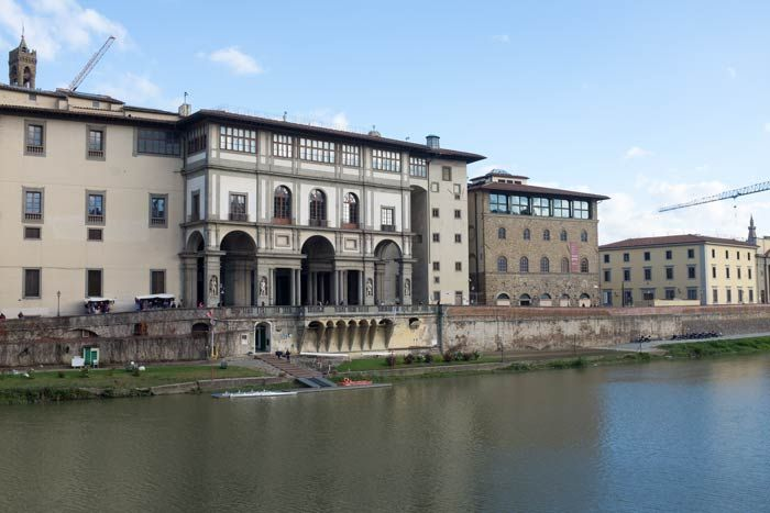 The Uffizi Gallery in Florence viewed from the-opposite bank of the River Arno