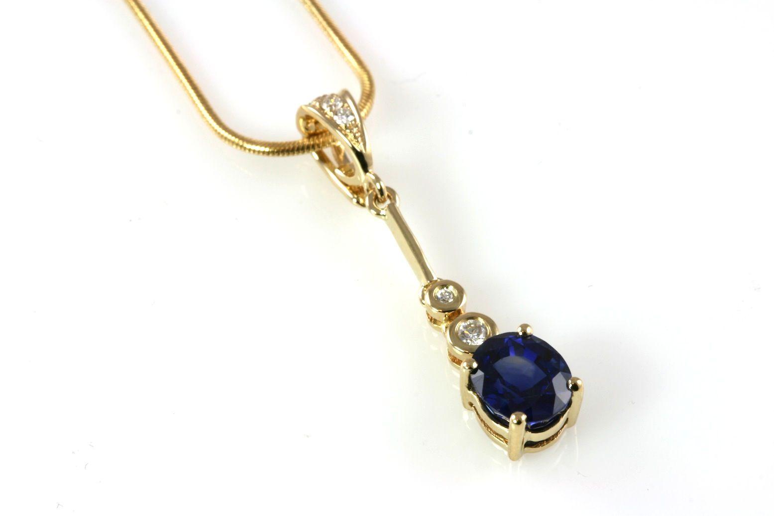 K yellow gold pendant with bezel set diamond accents diamond