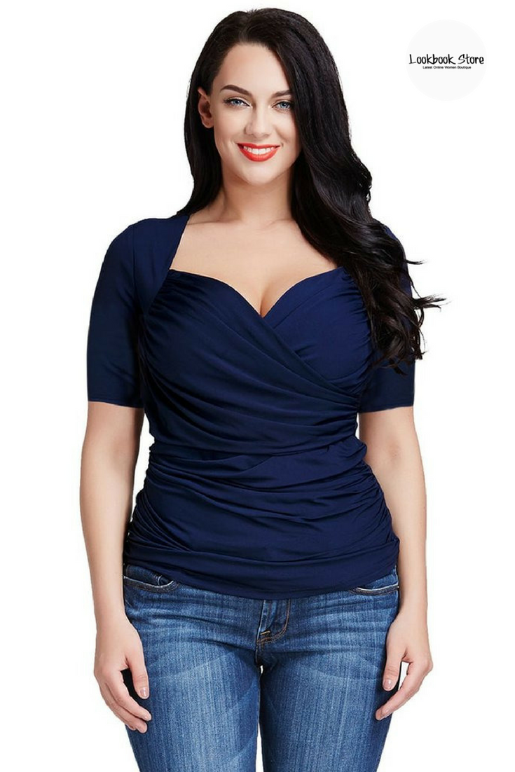 c11da06c587 Street Style // Create a fabulous outfit with this plus size navy ruched  surplice top.