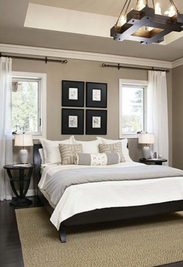 The cliffs cottage at furman black headboard neutral walls and white bedding Master bedroom with grey furniture