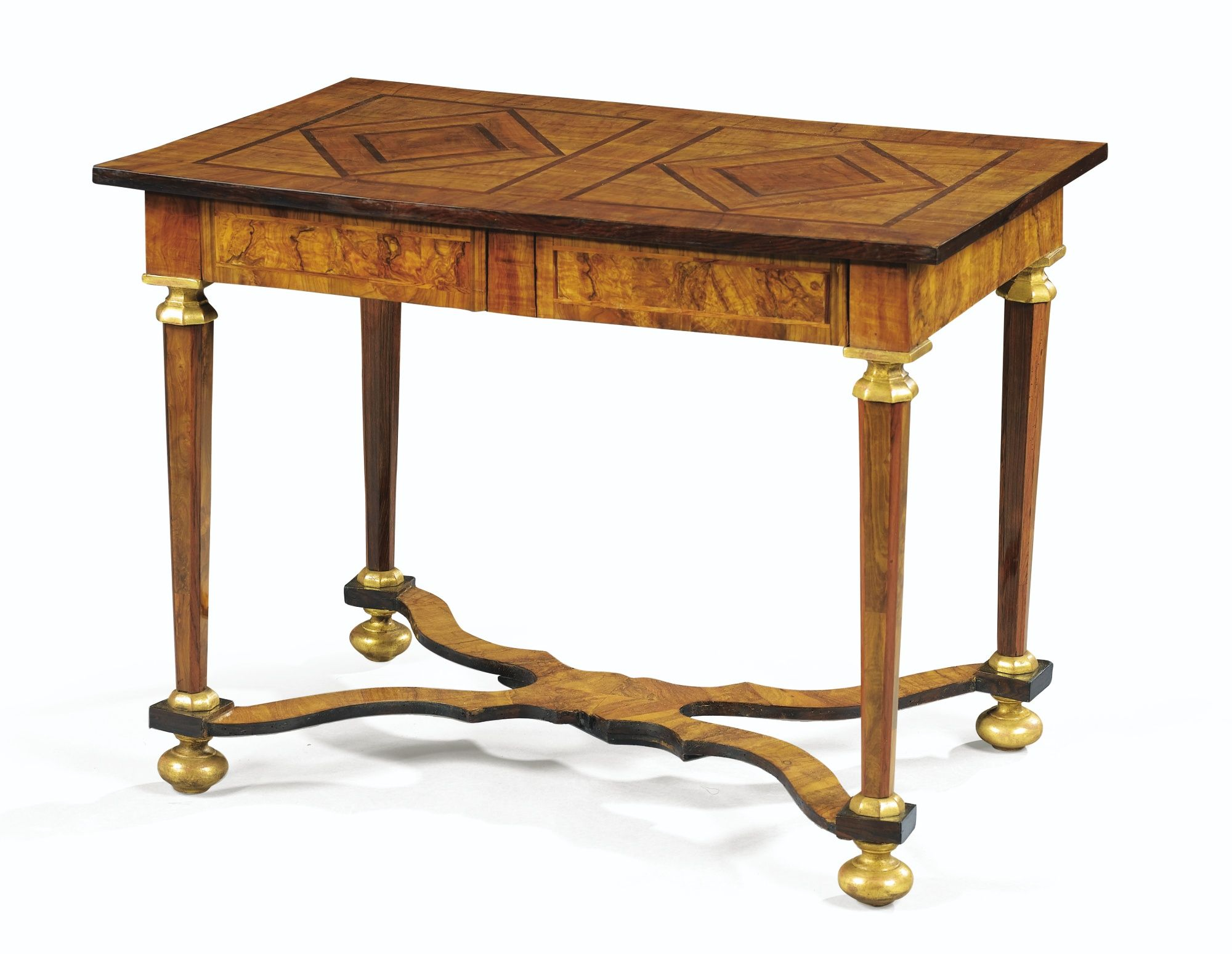 date unspecified A PARCELGILT OLIVEWOOD TABLE, LOUIS XIV