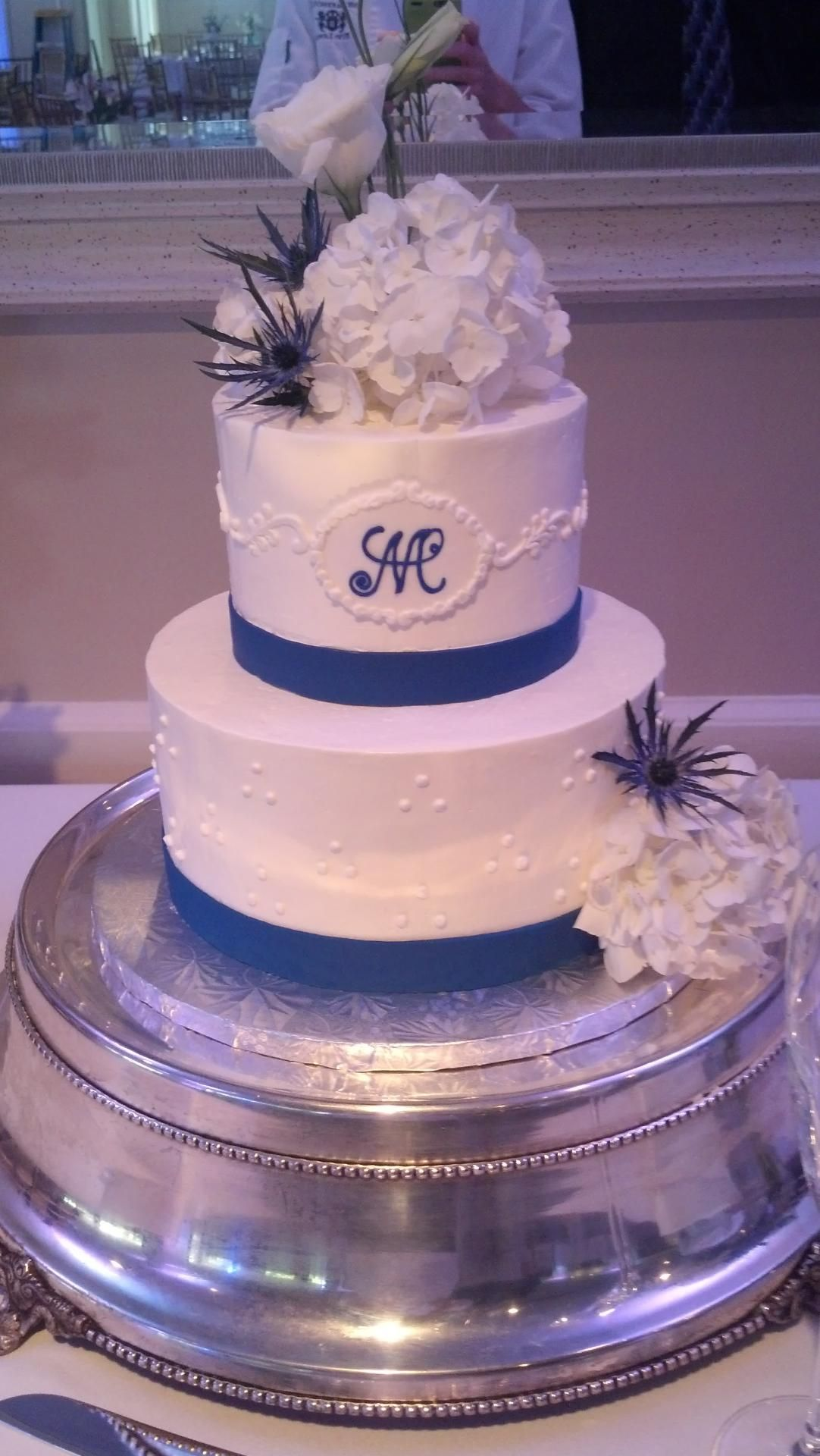 A two tier wedding cake with Italian buttercream frosting, fondant ...