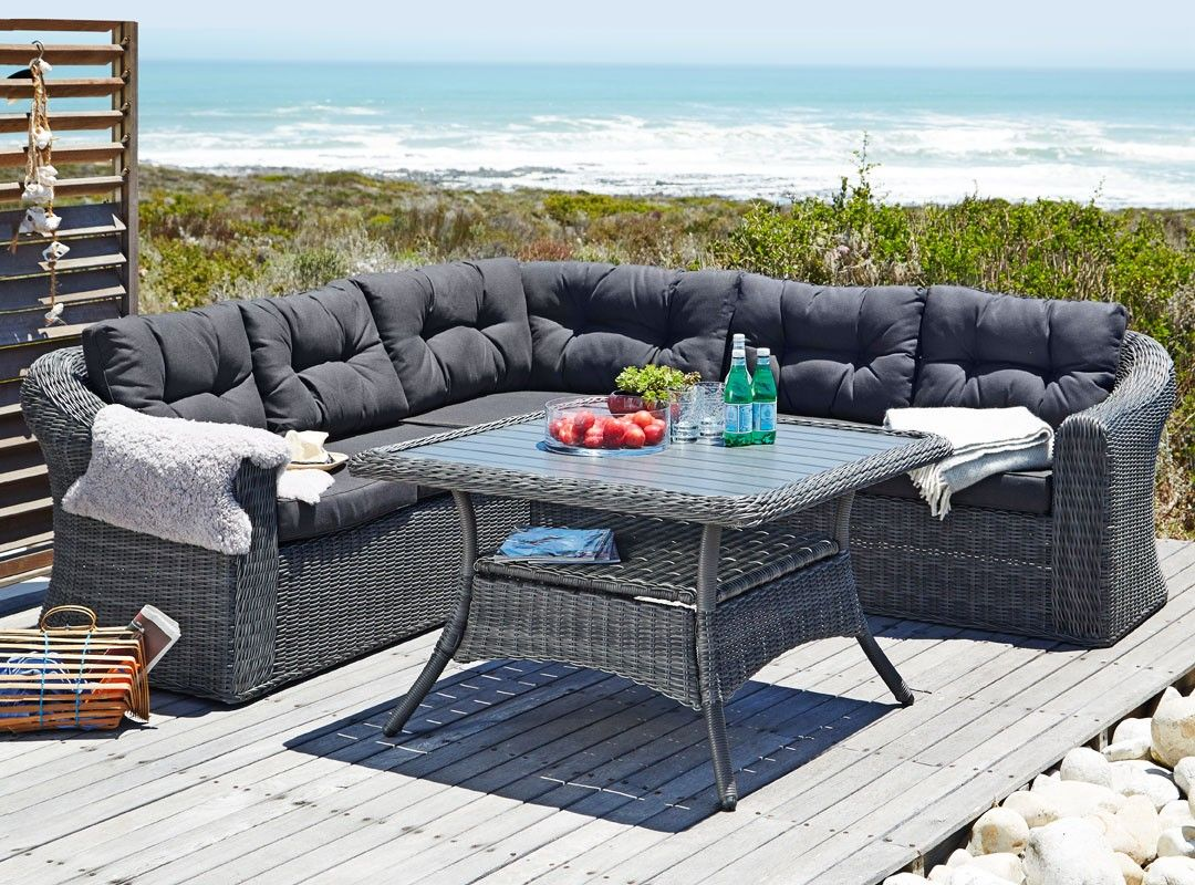 Luxurious Outdoor Sectional Set And Dining Table Featuring A