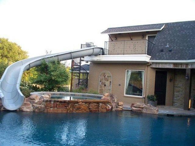 house slide from deck into pool