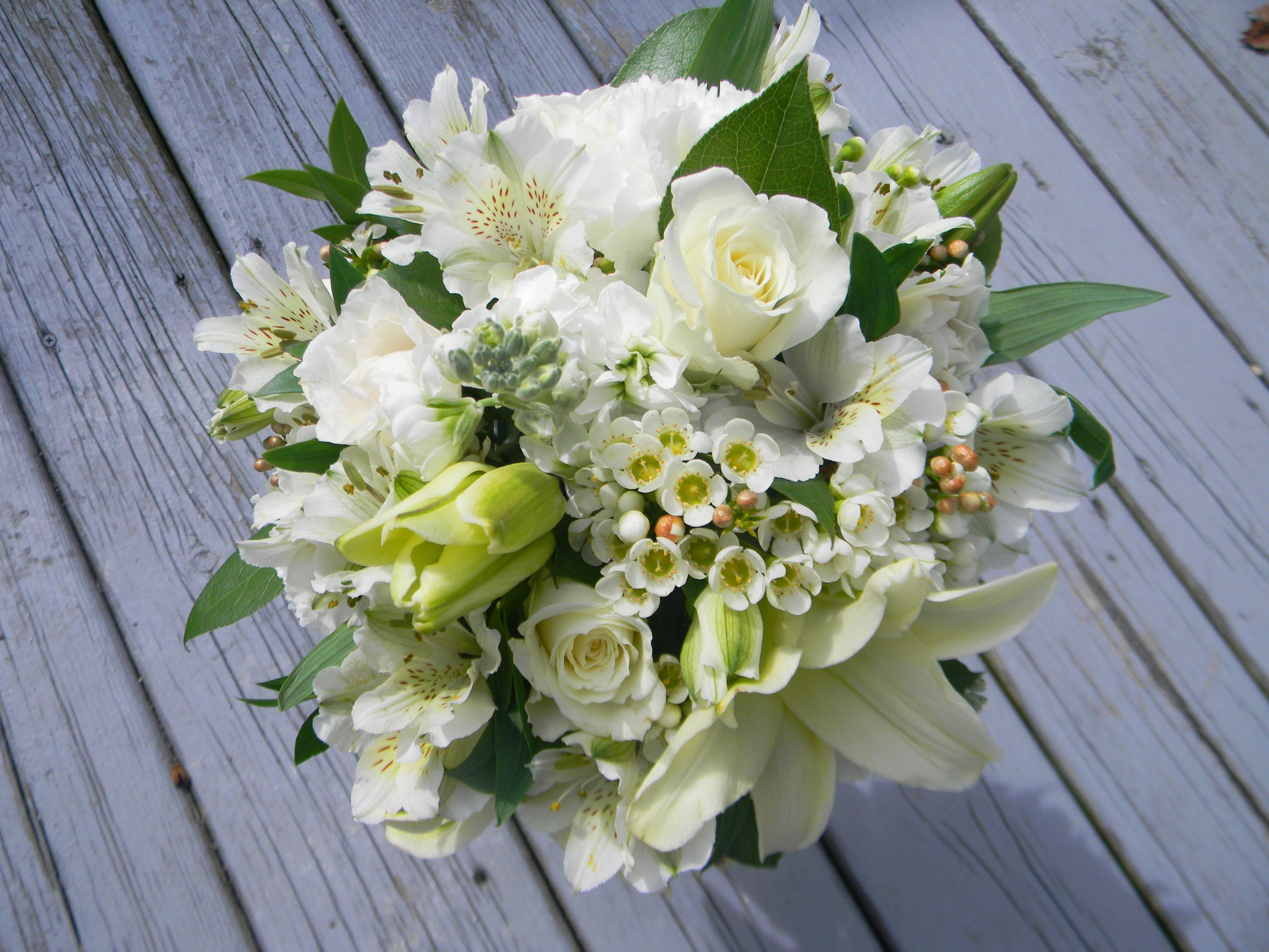 All White Bridal Bouquet With Lots Of Texture And Varying Size
