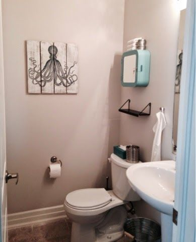 small powder room makeover paint colour is sherwin williams city