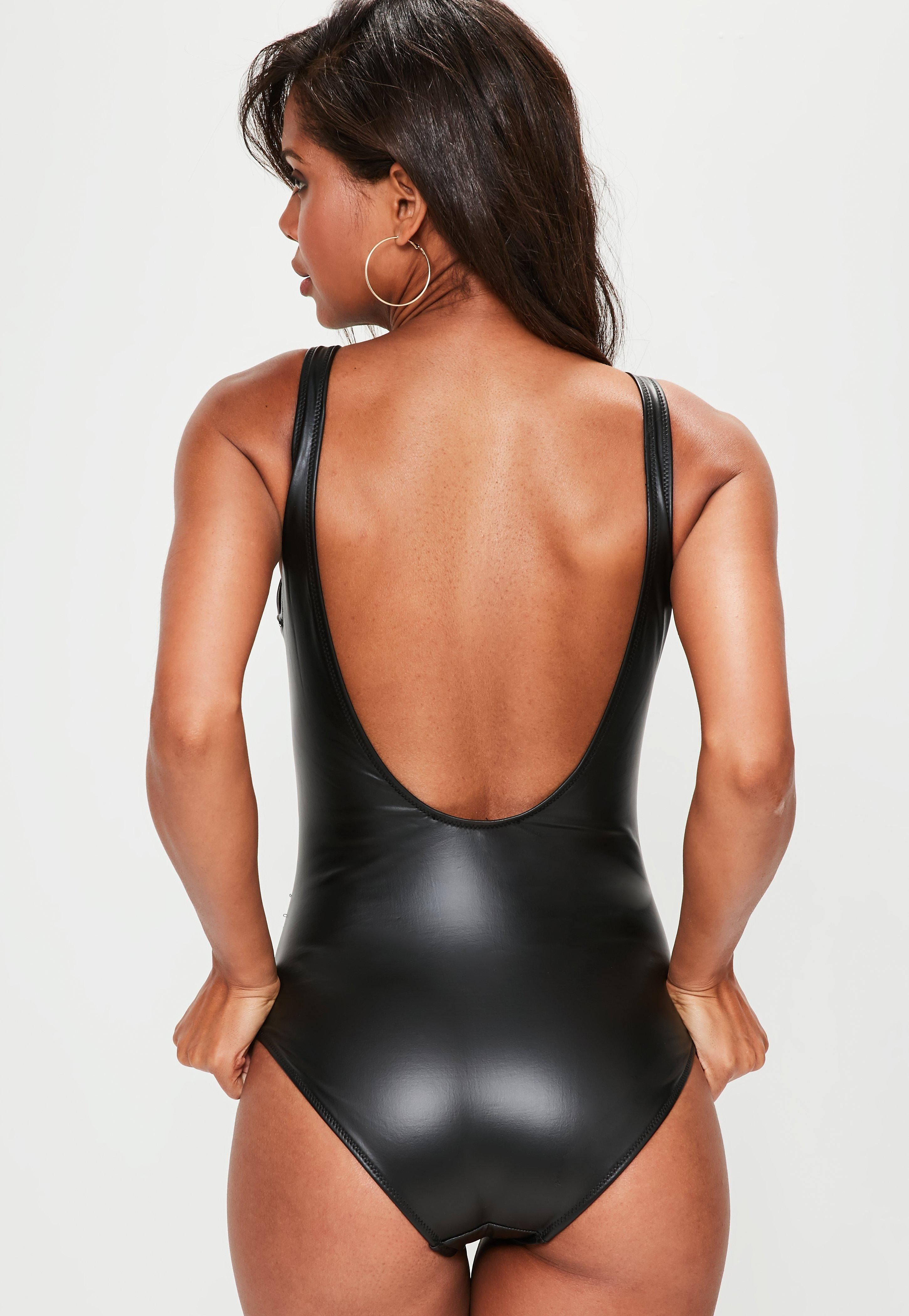 e0cf500fd Zip it like it s hot with this black wet look swimsuit with a front zip and  flattering fit.