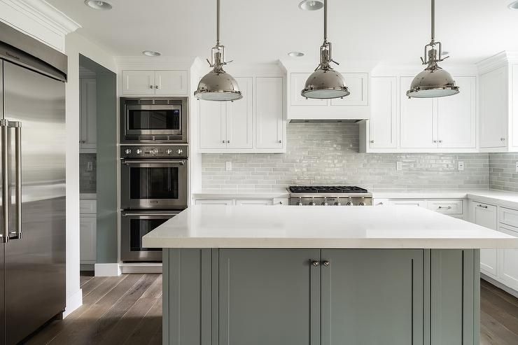 White and grey kitchen features white perimeter cabinets for Gray and white kitchen cabinets