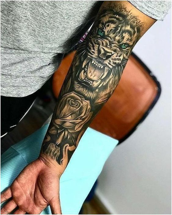 Lion Tattoo Meaning Lion Tattoo Ideas For Men And Women With Photos In 2020 Leopard Tattoos Best Sleeve Tattoos Tattoos