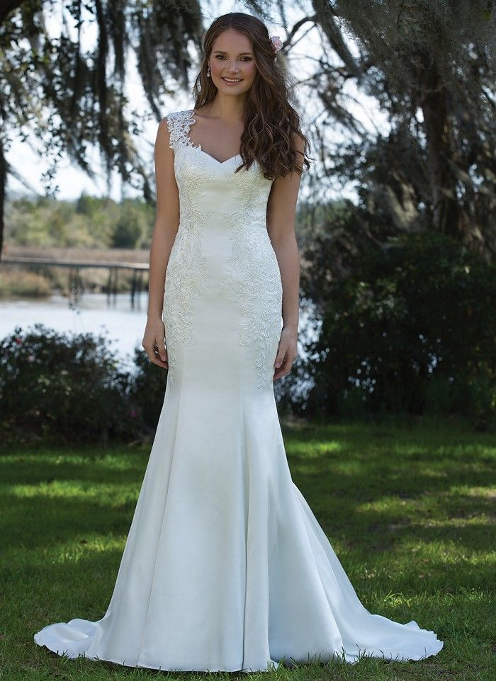 This fit and flare satin gown showcases a Queen Anne neckline, sequin appliques, low illusion back, and chapel length train. https://www.sweetheartgowns.com/sweetheart/6190