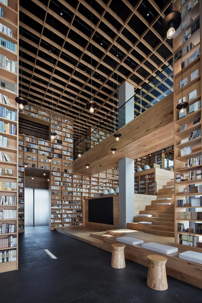 Photo of beijing fenghemuchen space design builds yue library as wooden forest of books in hangzhou