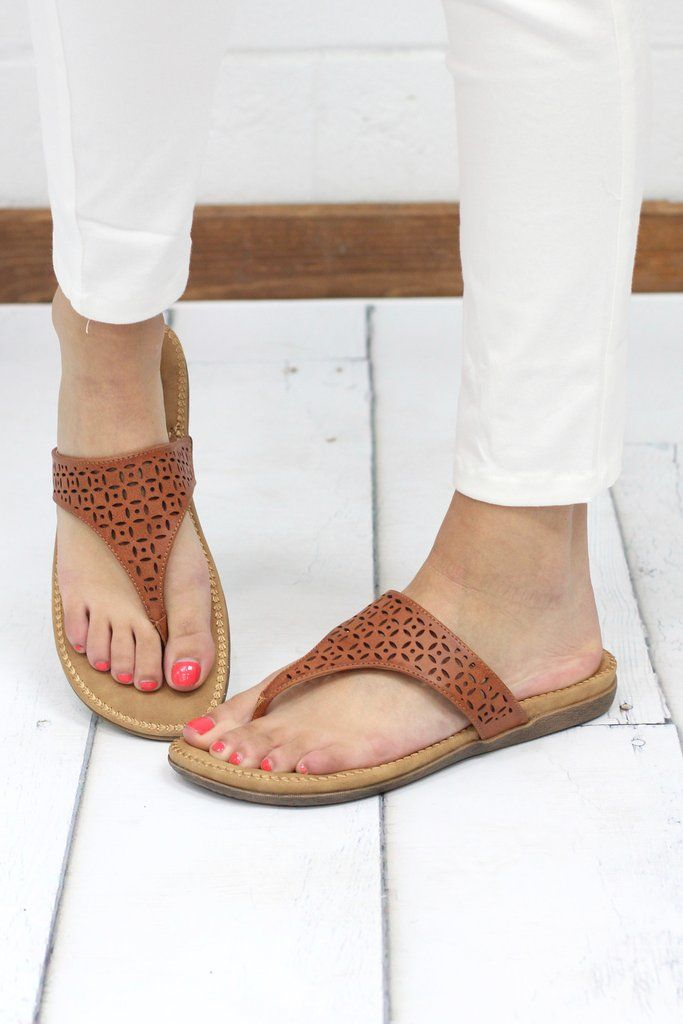 74b61ea65ba14 Super comfortable flip flop sandals from Volatile Footwear. Features laser  cut details int he tan leather. Thick footbed with extra cushion. Tan in  color.