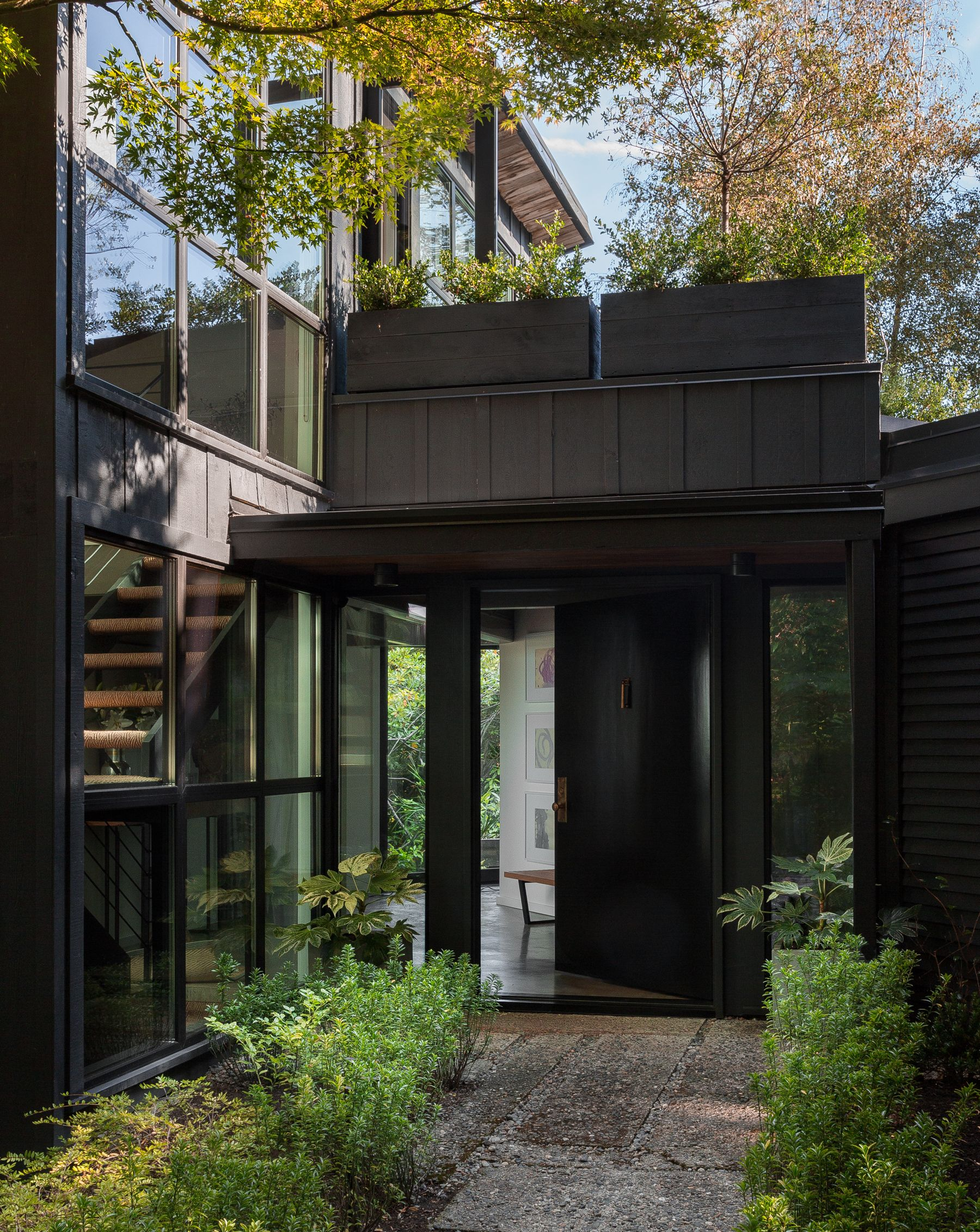 Exterior modern siding window design  a  midcentury in seattle receives a striking makeover  home and