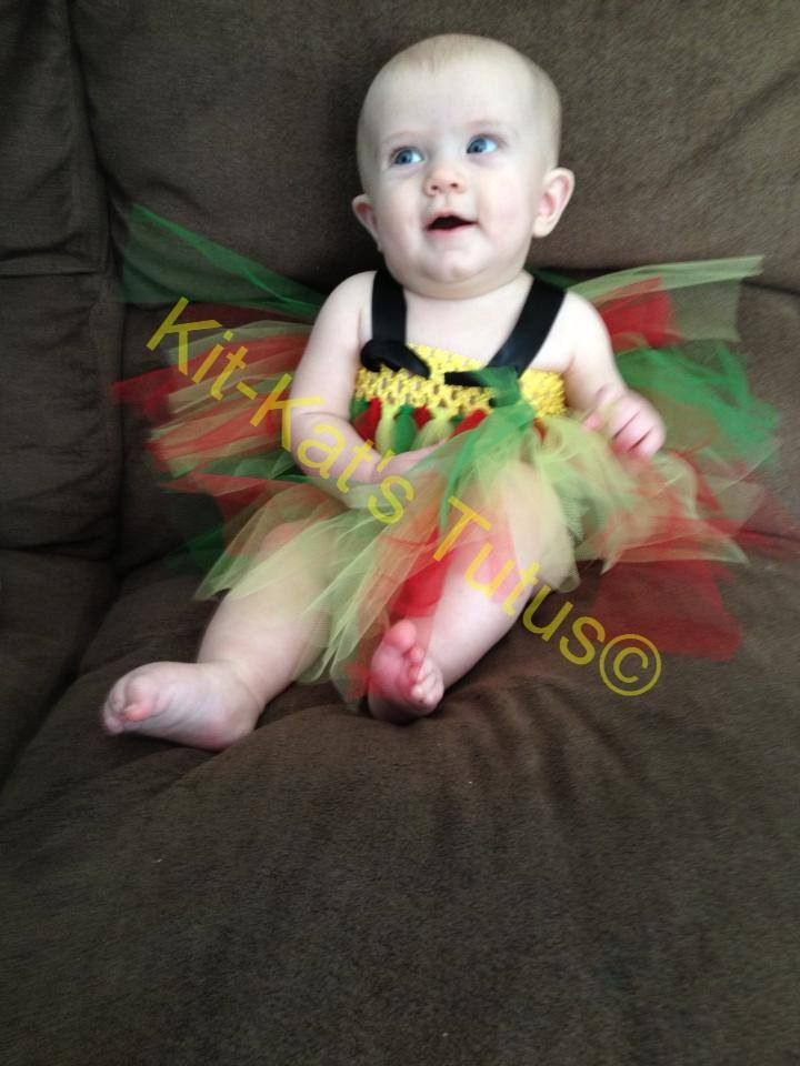 Robin Tutu dress, $29 free shipping in the USA on this or the Batman tutu dresses!   Like Kit-Kat's Tutus on Facebook!  A portion of the proceeds goes towards getting my son with autism, an autism therapy dog!