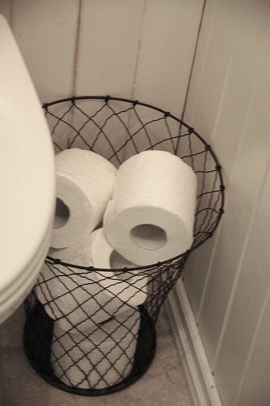 STORAGE | TOILET PAPER : Mesh wire waste basket as a toilet paper cache.